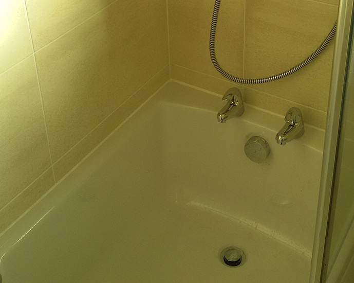 Tiled bath with shower